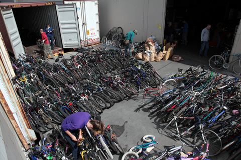 The bicycles are staged outside the container and then loaded by size like a giant jigsaw puzzle.